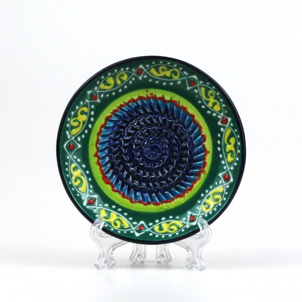Keramik Reibe mit bunten Ornamenten auf türkis