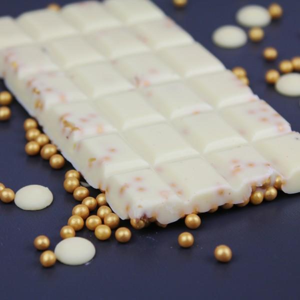 Weiße Schokolade mit Goldkugeln