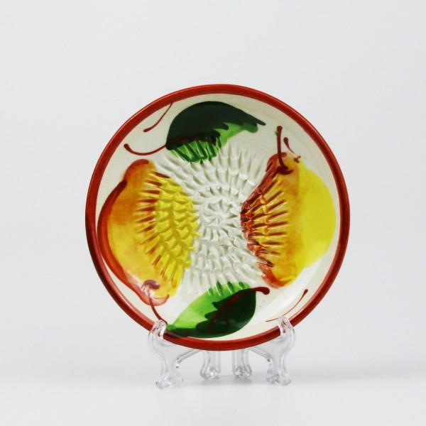 Keramik Reibe mit fruchtig frischen Zitronen